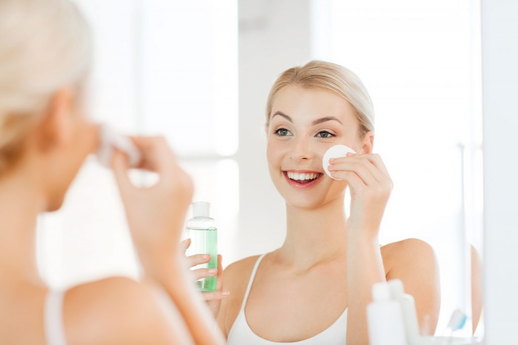 Woman putting cleanser