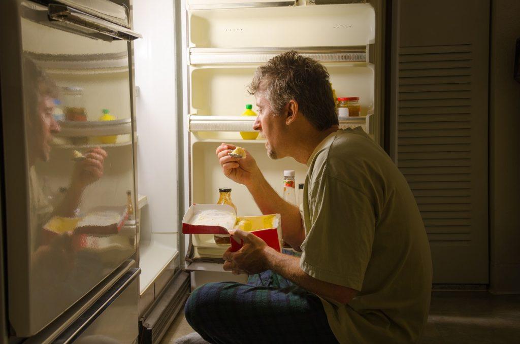 Man stress eating at midnight