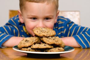 Kid looking at the cookies