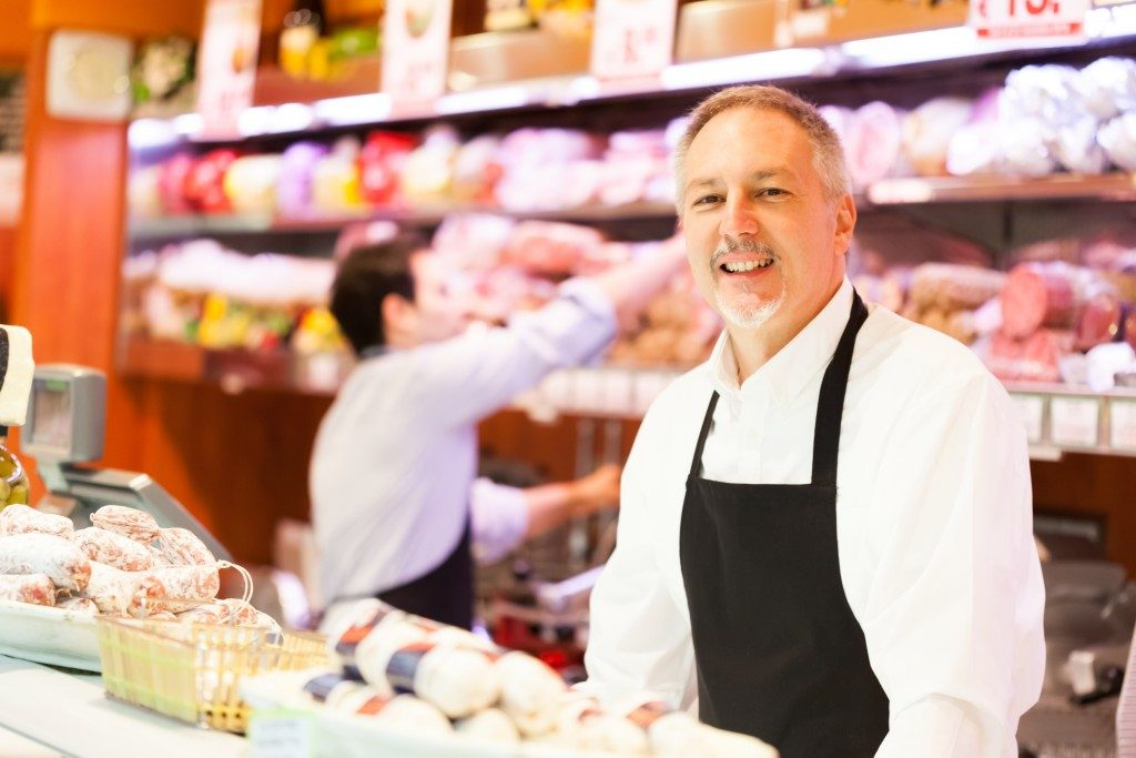 man in proper outfit at deli shop
