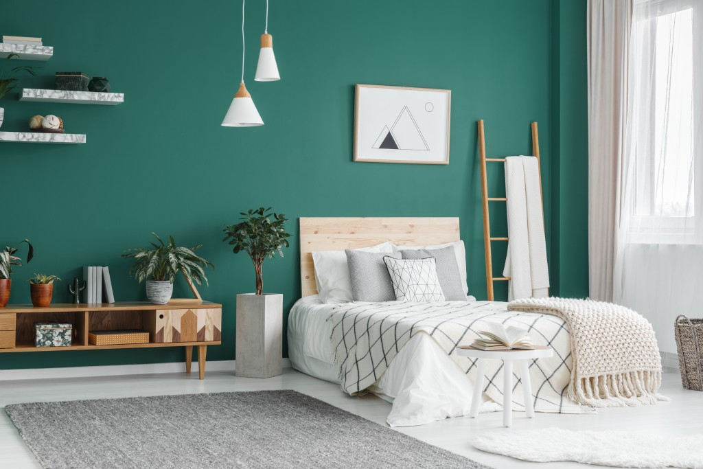 bedroom interior with green painted wall