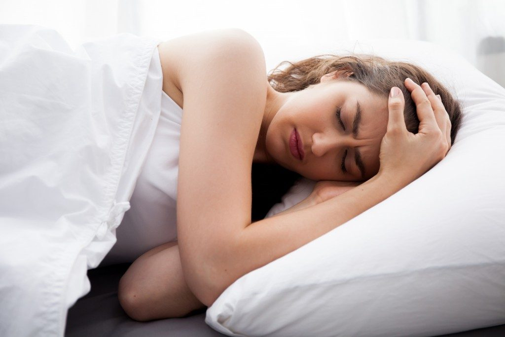 woman suffering from strong headache