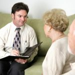 funeral director talking to old couple