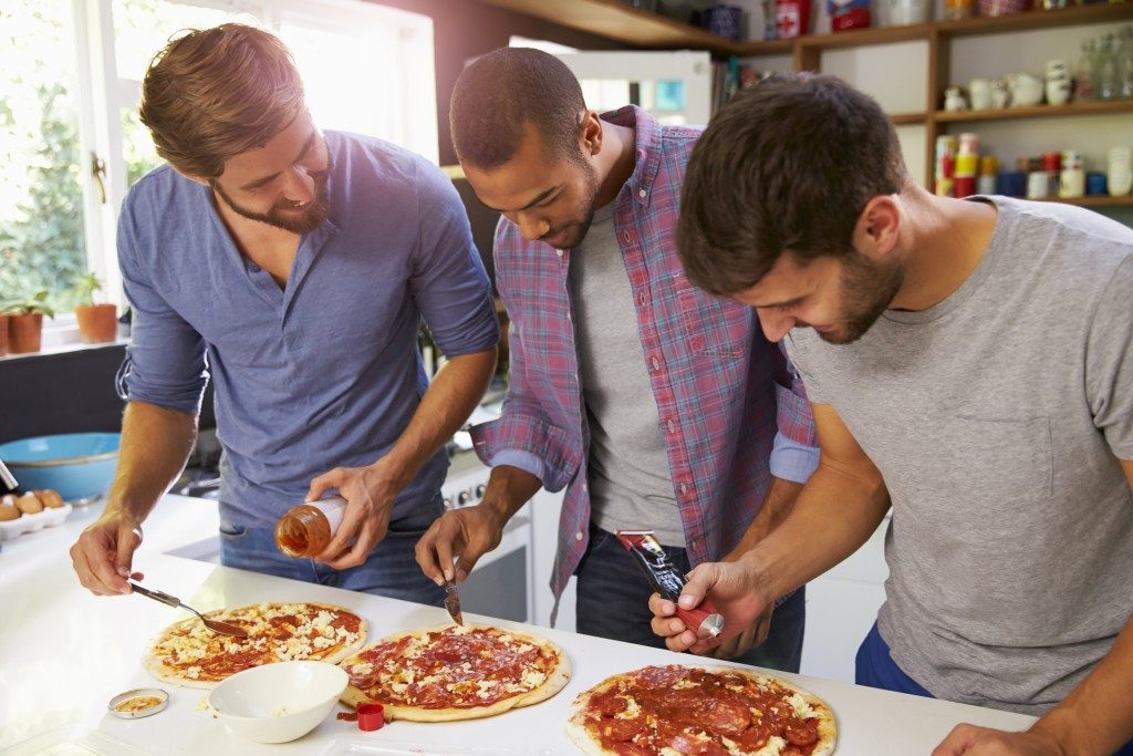 Group of friends making pizza
