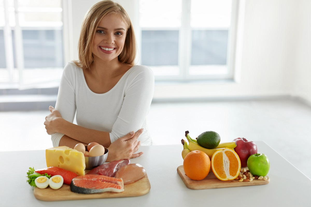 woman with fruits and vegetables on the table