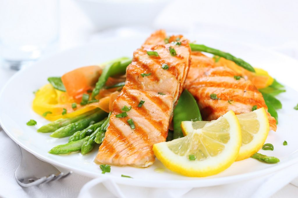 plate of grilled salmon with lemon