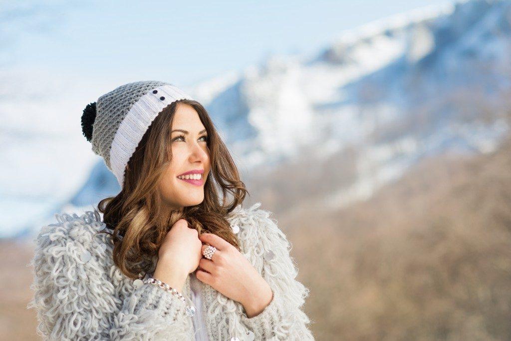 girl wearing winter apparel