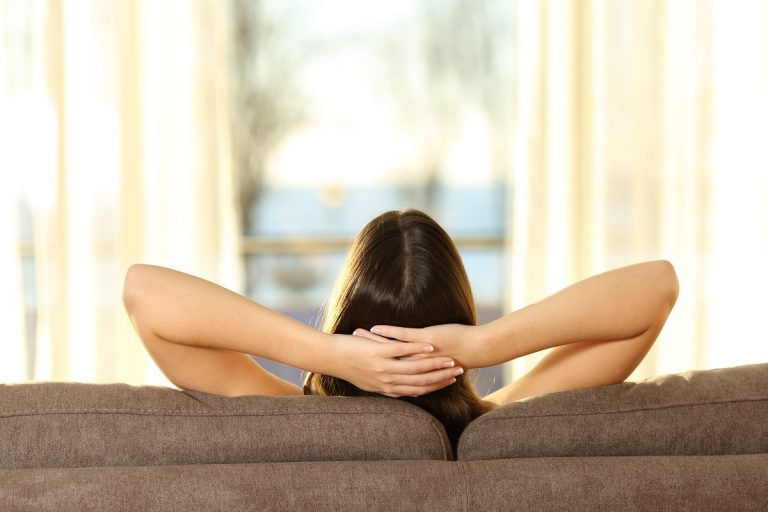 woman relaxing at her couch