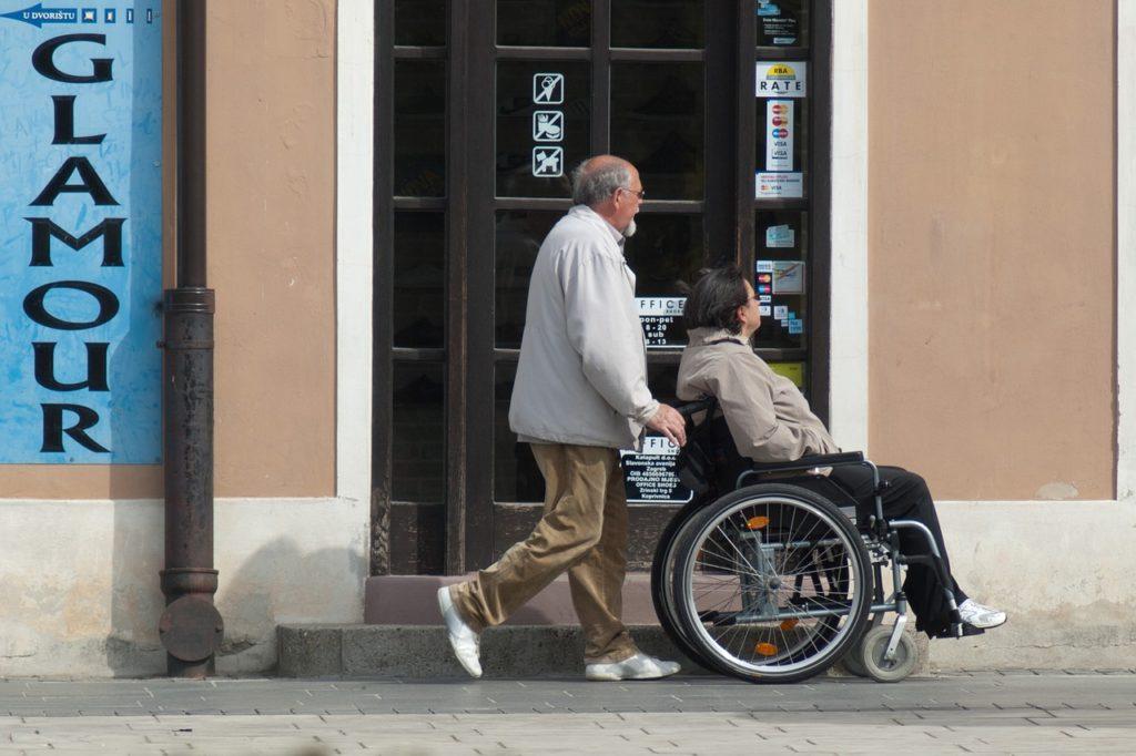 man pushing a woman on a wheelchair