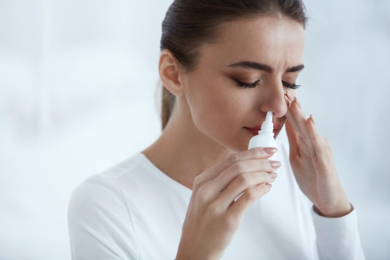 woman having an allergy attack