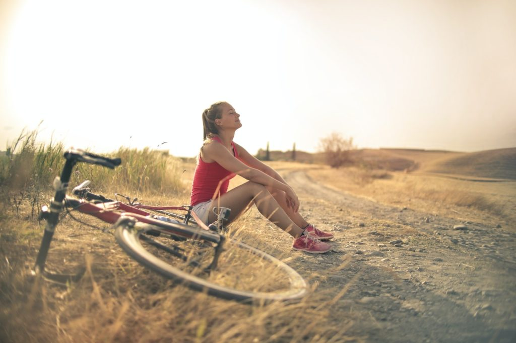 woman resting from biking