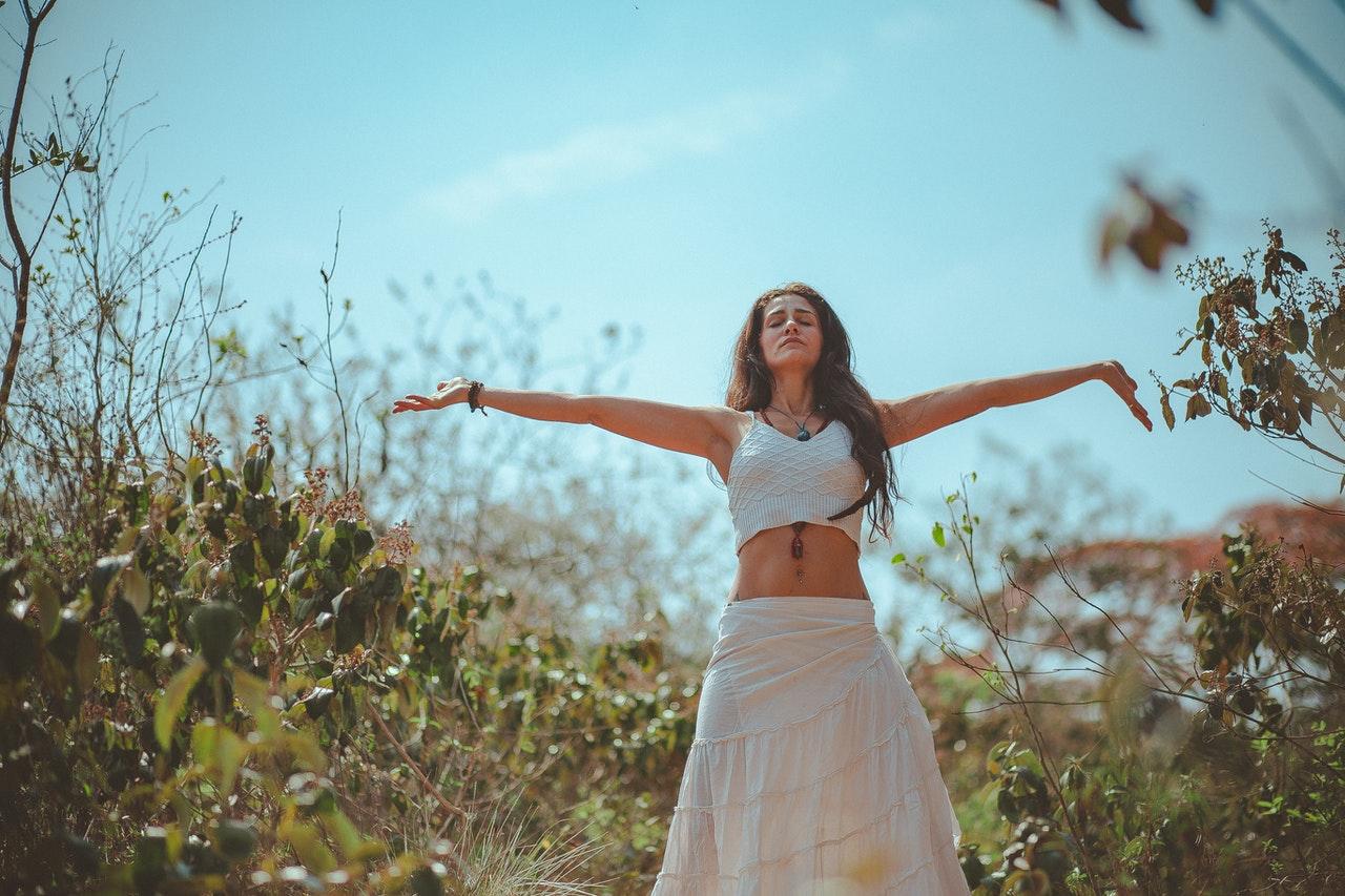 woman outdoors meditating
