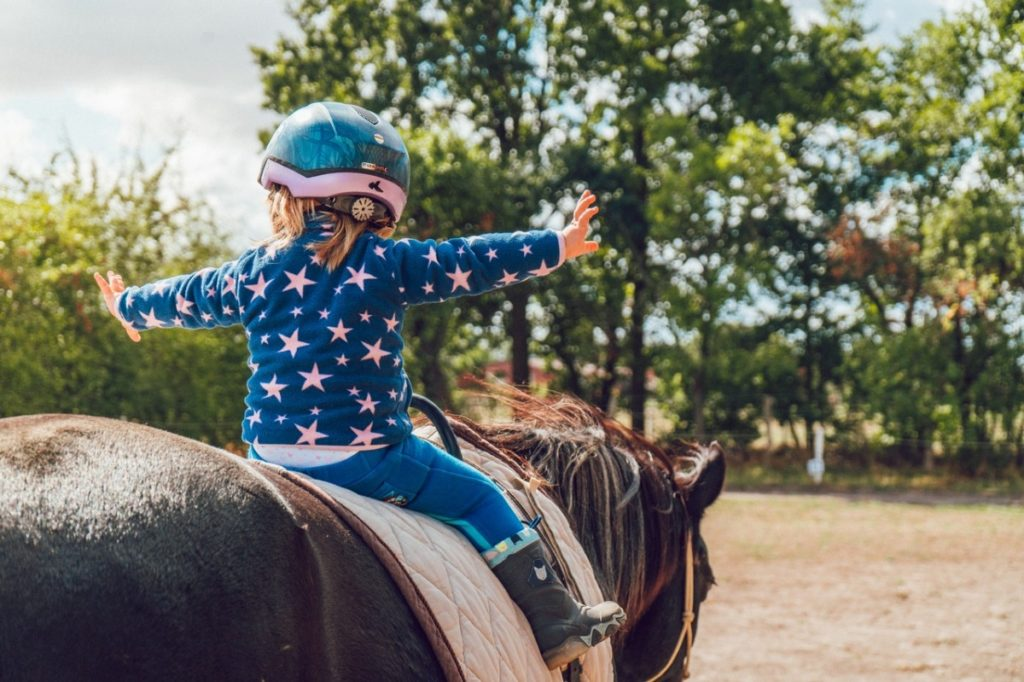child riding on a horse