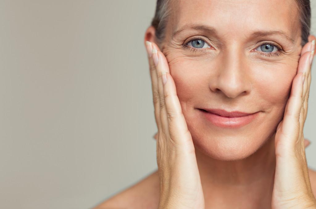 woman doing facial care