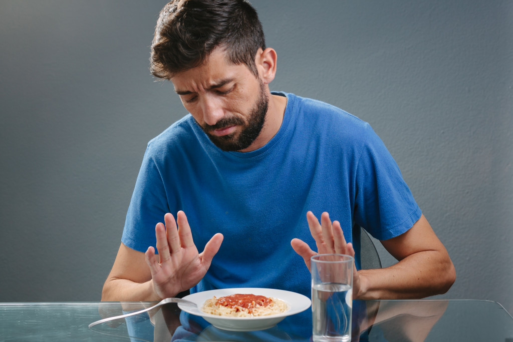 man avoiding food