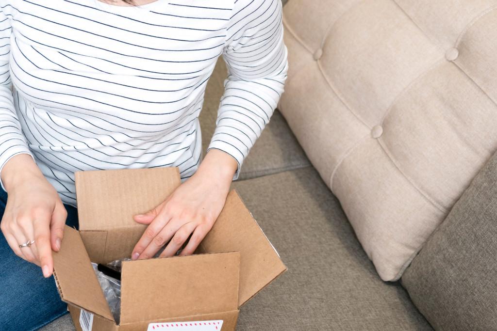 woman opening a box